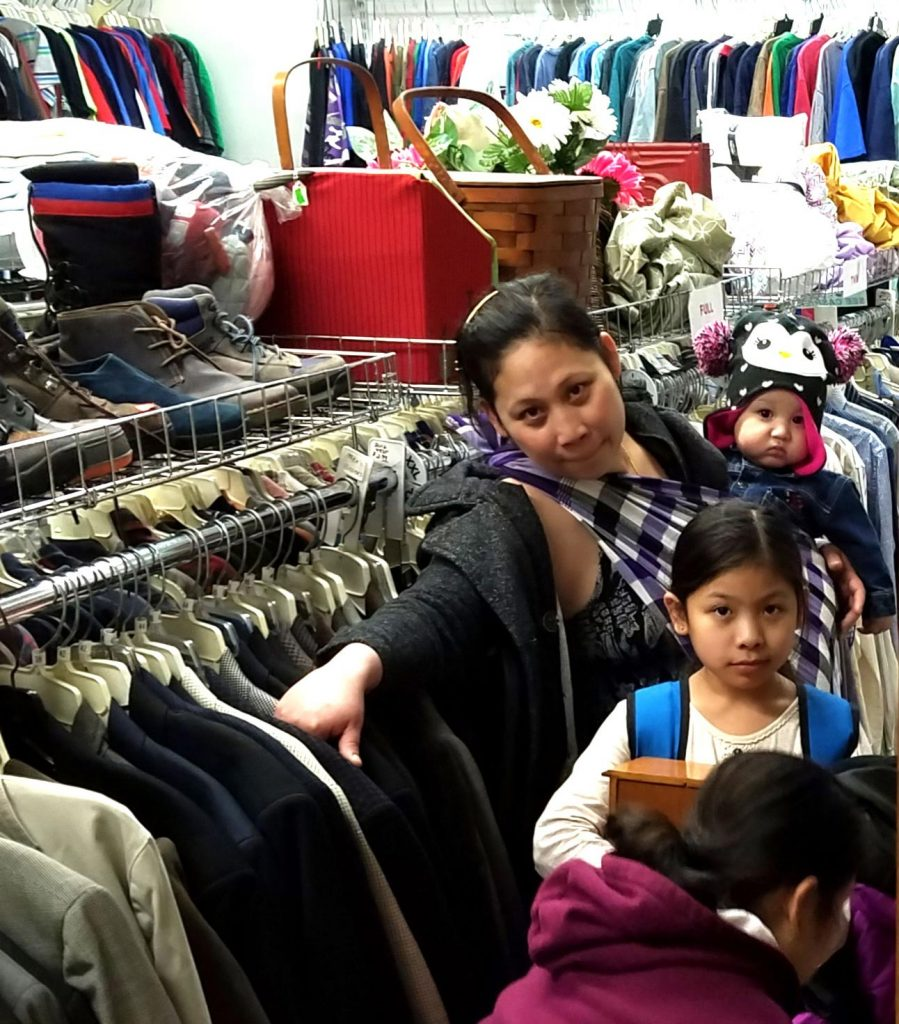 Family shopping in Heart's thrift shop