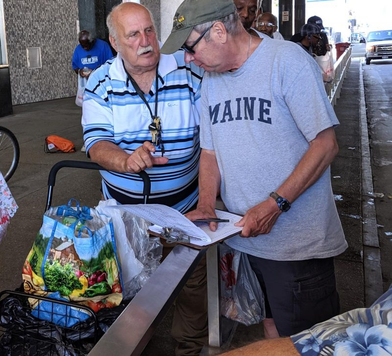 Hearts for the Homeless - Man receiving food