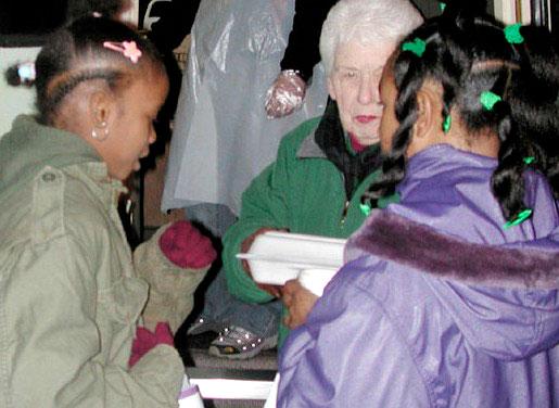 Two little girls receiving food