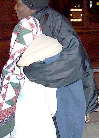 Man receiving blankets
