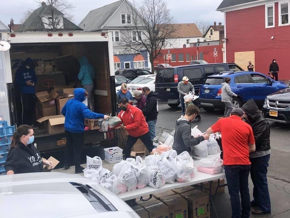 BDC volunteers distributing food in the Hearts parking lot