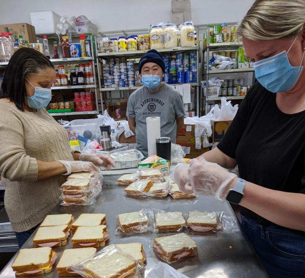 Volunteers make sandwiches for the homeless and poor.