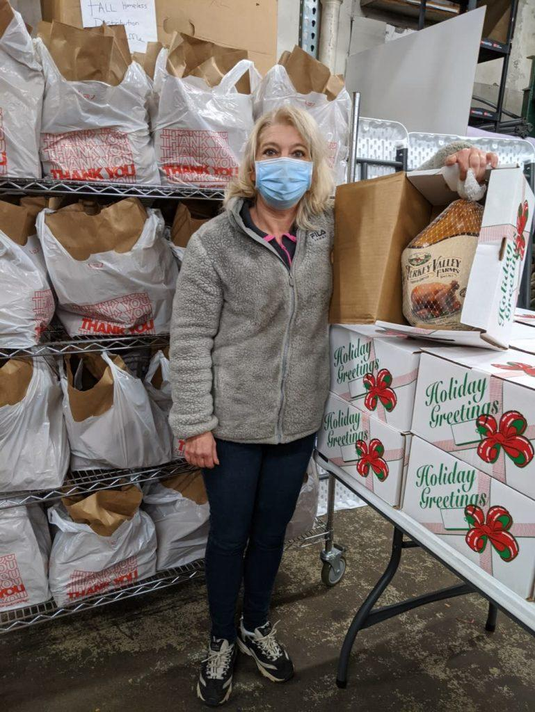 Women standing with food boxes