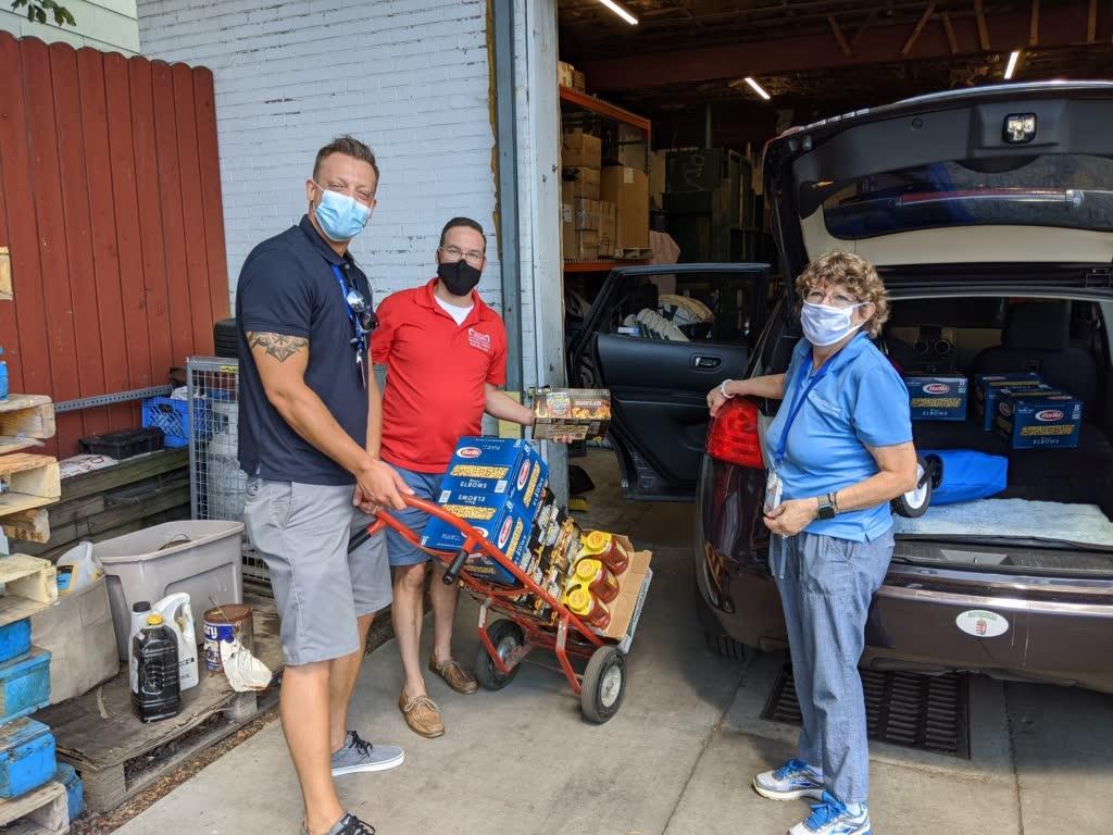 Loading/unloading a car - food donations