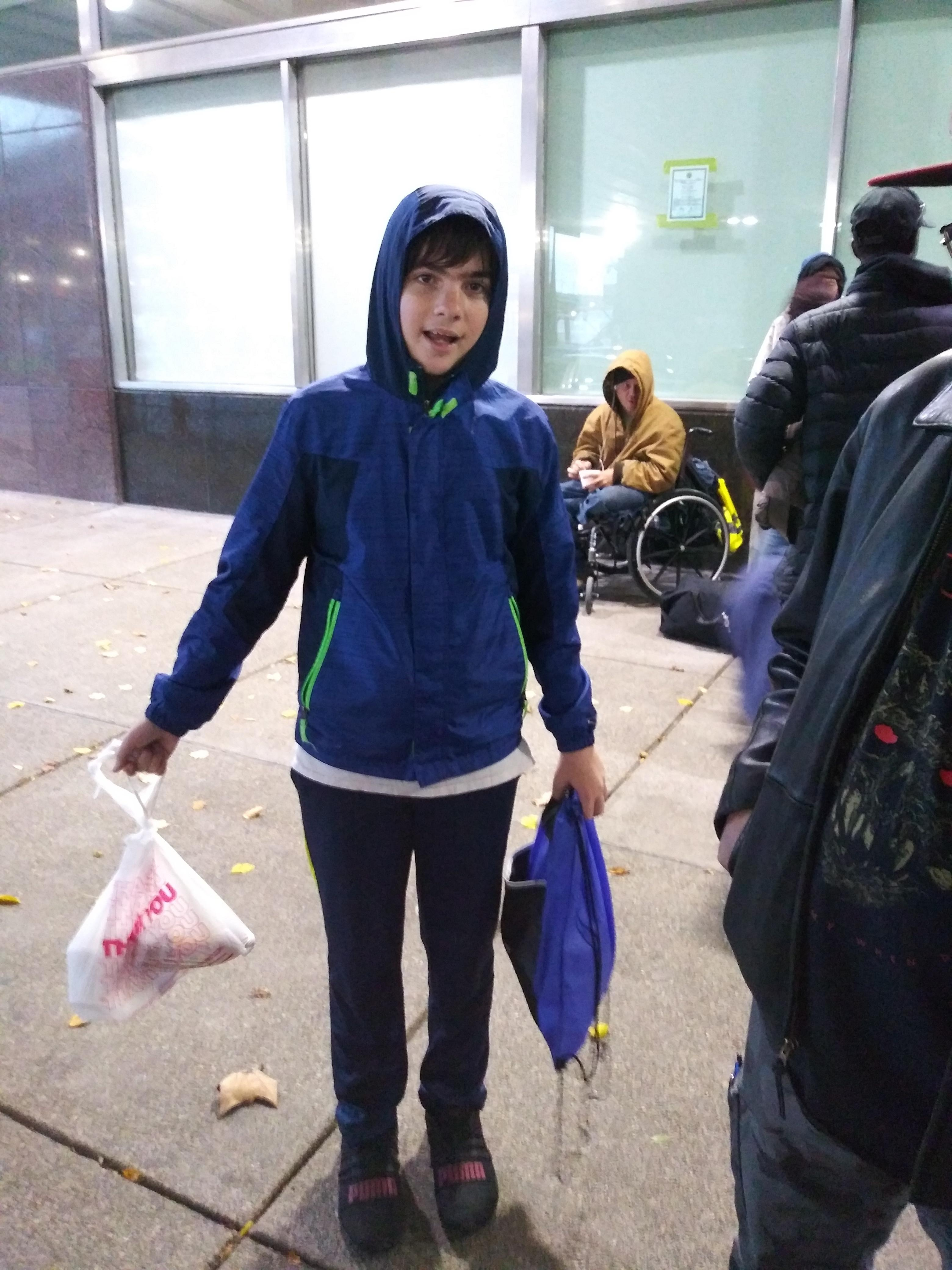 Boy holding bags