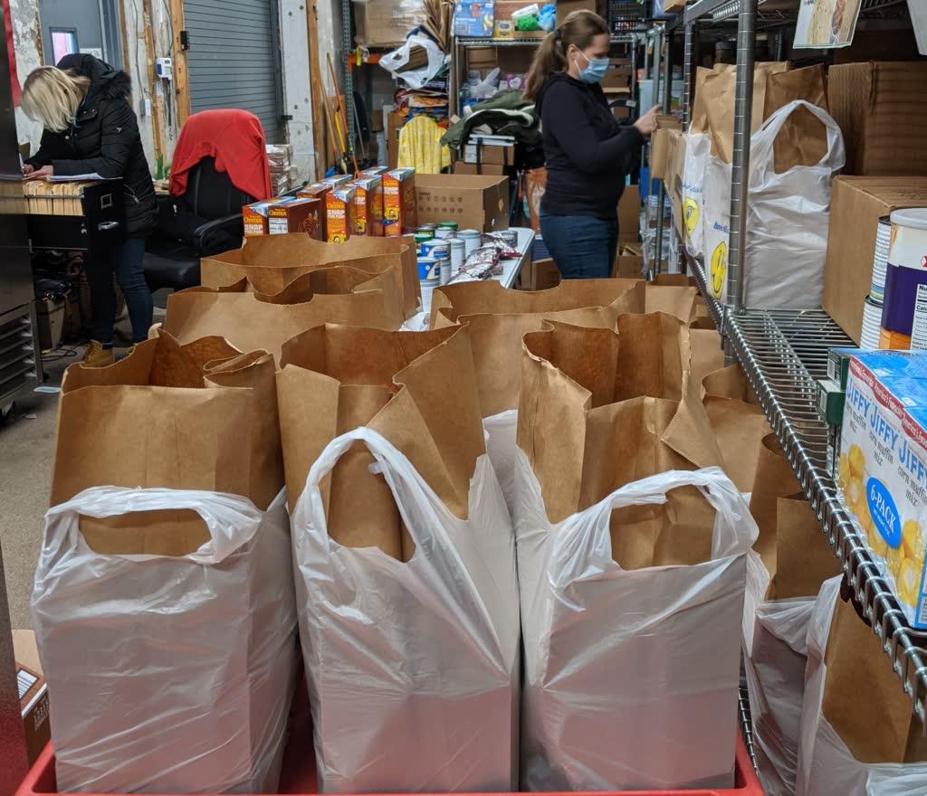 stephanie bagging groceries