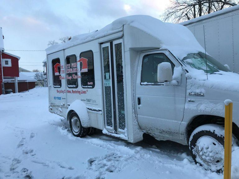 Hearts bus covered in snow