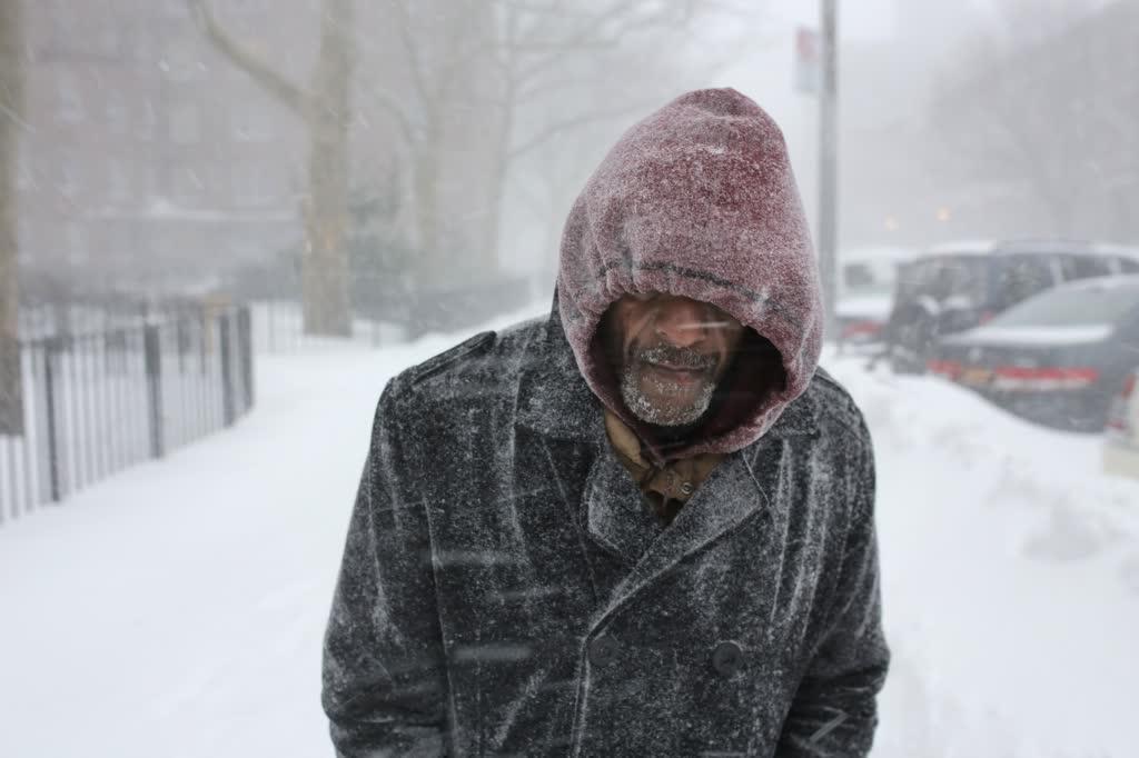 Man walking in a snow storm