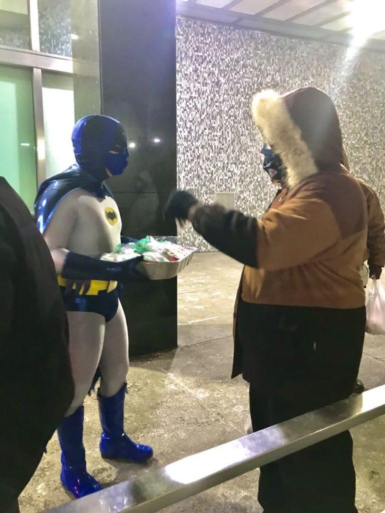 Batman serving cookies