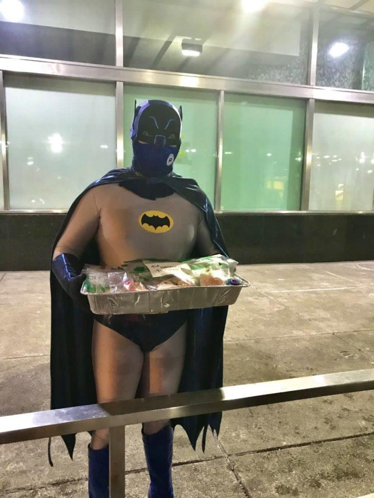 Batman holding cookies