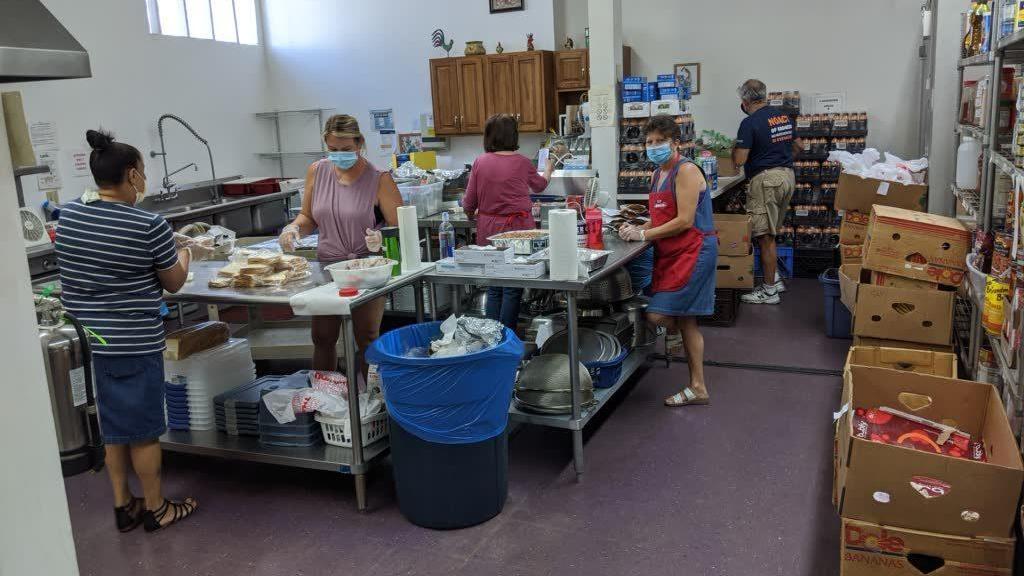 kitchen workers preparing meals
